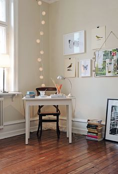 Perfect office space...Lights - Check; Butterflies - Check; Books - Check; White desk - Check!!!