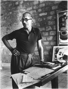 Le Corbusier ( Charles-Edouard Jeanneret ) working in studio