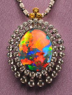 DREAMTIME Black Opal Pendant Black Opal 18.020 cts. Diamond 3.103 ct. Yellow Diamond 0.259 ct. Pt 900, K18YG Product Code: AT154