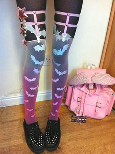 Oh my lovely! The bat tights with the ombre' transparent socks is so cute! Transparent clothing is amazing with prints underneath! And, that hair clip on the garters is a wonderful touch. Very original!