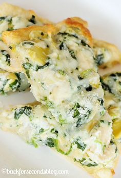 "This Spinach Artichoke Dip Pizza is a combination of two of the most popular foods: pizza and the best ever recipe for spinach artichoke dip! This is so crazy delicious, I could seriously eat it everyday! Recipe <a href=""http://backforseconds.com/spinach-artichoke-dip-pizza/""><strong>HERE.</strong></a>"