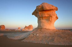 The White Desert, Egypt..The fabled White Desert of Egypt can be found 28 miles north of the town of Farafra. The desert has an other worldly beauty with bizarre, ghost-white rock formations sprouting from the desert sands. The strange structures are actually huge chalk formations created as a result of occasional sandstorms in the area.
