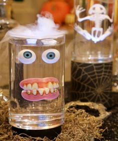 Suspend body parts or fake skeletons in clear gelatin in a Jar. Like American Horror story.