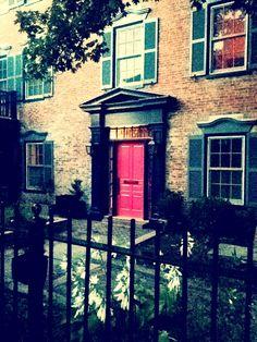 Brick with pink door accent.