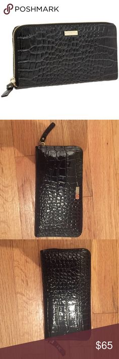 """Kate Spade ♠️ Knightsbridge Wallet Black Kate Spade ♠️ Knightsbridge Neda zip around wallet. Dimensions: 7 1/2""""W x 4""""H x 1""""D. Excellent used condition.                                     -Exterior slip pocket. -Interior zip and currency pockets; twelve card slots. -Leather. kate spade Bags Wallets"""