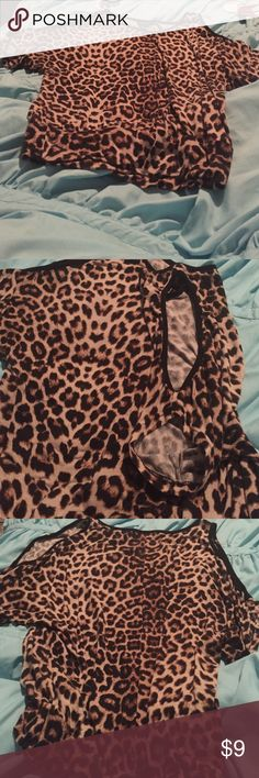 Really cute Cheetah blouse With open cut outs on the sleeves and arm holes favorite top has had great use in great condition Rue 21 Tops Blouses