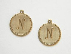 Raw brass letter  N  initial charm. These charms have a detailed monogram letter on the front and a smooth flat back. Pair them with one of