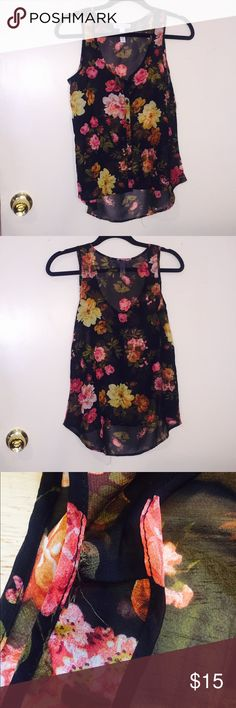 """🎀Final Sale🎀 Sheer Black Floral Tank Cute sheer floral tank for a nice day out. There is a small hole on the left side of this beautiful tank due to storage so there's a discount on this piece :) Each piece in my closet comes hand wrapped with ❤️ Feel free to send me any reasonable offers by clicking the """"offer"""" button down below and we can negotiable from there :) Please check out the other listings in my closet as well! Happy Poshing ❤️ Ambianc Apparel Tops Tank Tops"""