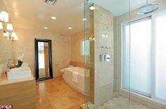 joe manganiello -  His and her sinks, a walk-in shower and sunken tub make up the master bathroom