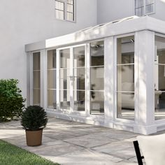 Loggia conservatory extension with super insulating columns on a white render house