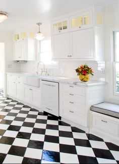 glass cabinets above - Get a Classic Black & White Checkered Floor on Any Budget