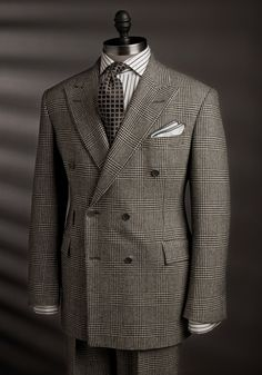 Fine suit and fine example of pattern mixing.  http://www.moderngentlemanmagazine.com/mens-style-suits-pattern-mixin