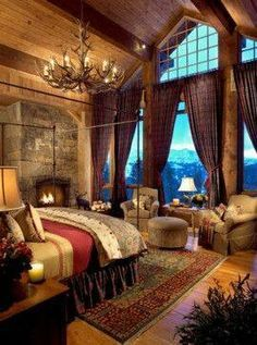 gorgeous rustic bedroom with stone fireplace