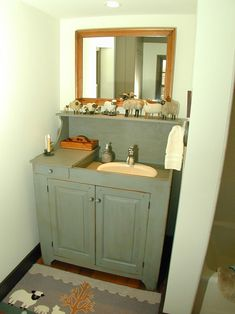 Cabinet around sink would make out stand alone sink look sooooo much better