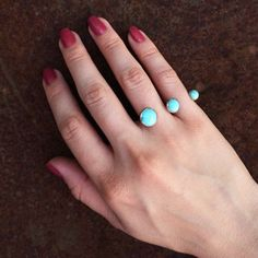 Sterling Silver and ascending Turquoise ring. Size 4.5 x 5. Please inquire about other sizes.