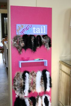 The cat tail station was a lot of fun for the kids. I simply got boas and cut them into various lengths. On the shelf, I had safety pins set out for the parents to attach the tails to outfits. I was so happy that even the boys took part in the kitty cat tails.