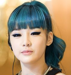 Lovely Dyed Locks- Park Bom from 2ne1. Love the hair color.