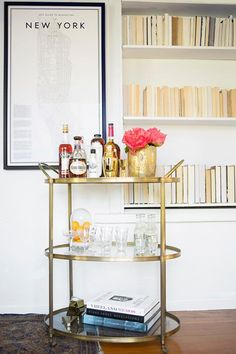 "Nothing beats a fabulous bar cart when it comes to adding a touch of glamor and sophistication to your home. Whether you're the ""hostess with mostess"" or more of a casual entertainer, a perfectly styled bar cart creates an cheery focal point and inviting space for your guests. With just a few essentials and intentionally placed vintage decor, you can create a bar cart that's bound to wow guests."