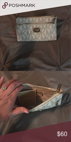 Michael kors authentic cream clutch Like new ! Used a handful of times ... flawless!!!! Original mk authenticity card inside from when originally  purchased Michael Kors Bags Clutches & Wristlets