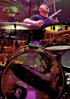 Jason Bonham, saw him at a drum off, man his dad taught him well
