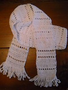 This scarf was designed as a project that incorporates the basic stitches and techniques of row crocheting. It is suggested that beginners use DK weight cotton yarn but the pattern is adaptable to any weight yarn. Simply use the suggested hook size and gauge given on selected yarn.