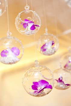 hanging flower orbs with orchids Photographed by Holly Jones Photography