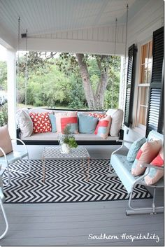porch seating swing PLUS bench and chairs. I might be able to fit this! Love the cushions!!!