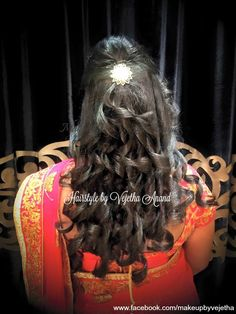Indian bride's reception hairstyle by Vejetha for Swank Studio.  Tamil bride. Telugu bride. Kannada bride. Hindu bride. Malayalee bride. #Saree #Blouse #Design #HairAccessory #curls  Find us at https://www.facebook.com/SwankStudioBangalore