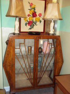 The art deco curio cabinet I just bought. This picture was on the stores website so the other items are not mine.