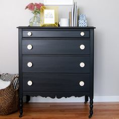 Matte black milk paint and bone hardware gives this antique dresser a modernized look while still keeping its vintage charm and feel.