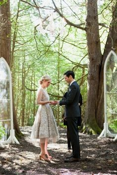 woodsy wedding ceremony with cathedral windows - photo by Joseph + Jamie Photography