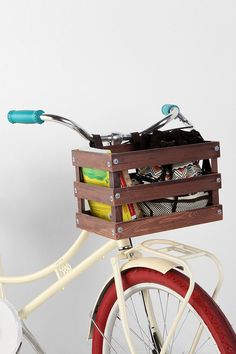 UO classic crate wood bike basket. I want something like this for the glow in the dark bikes I'm going to paint!