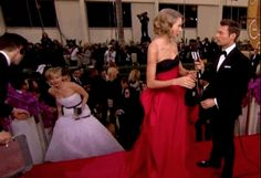 The moment only kept getting better when J-Law joked with T-Swift (a match made in abbreviated heaven) that she was planning on pushing her down the stairs. Then they both fan-girled with each other about their individual awesomeness. But fun fact, Lawrence has never attended a Swift concert, despite being invited several times.