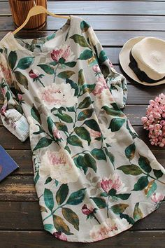 I would describe my aesthetic as definitely personal and harmonious with an eclectic yet bohemian sensibility. Besides, this floral dress is really flowy and comfortable when sitting on the beach.