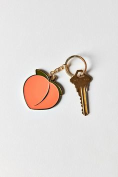 Feeling peachy keen with this sweet little keychain handmade in NYC by VERAMEAT. Peach-shaped charm with sleek metal edging + colorful enamel filling complete with a chain link + key ring. Gloss Labial, Metal Edging, Style Urban, Peach Aesthetic, No Bad Days, Things To Buy, Stuff To Buy, Just Peachy, Cute Cars