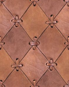 Tactile people will want to run their hand over this natural looking leather wallpaper. The wallpaper is of course made out of paper, but for those of you who want to decorate with natural materials, this is an amazing wallpaper. Cut-outs of rhombs fastened with leader string. Gorgeous!