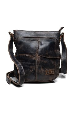40c25634c100 A cross body bag with an adjustable strap, multi use pockets and artfully  shaped folds