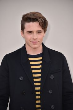 Brooklyn Beckham Photos Photos - Brooklyn Beckham wearing Burberry attends the Burberry Menswear January 2016 Show on January 11, 2016 in London, United Kingdom. - Burberry Menswear AW16 - Arrivals