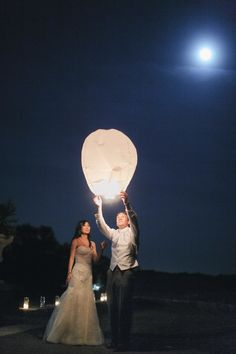 Sky Lantern -- stunning shot! See the wedding on Style Me Pretty:  http://www.StyleMePretty.com/tri-state-weddings/2014/02/20/gray-pink-white-trump-national-golf-club-wedding/ Photography: AhmetZe