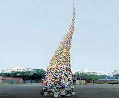 """Wang Zhiyuan designed a giant sculpture made entirely from trash called """"Thrown to the Wind"""" and 36 feet high."""