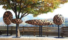 aehyo Lee, who uses wood logs to create & sculpt the beautiful pieces of art you see below. Enjoy :)