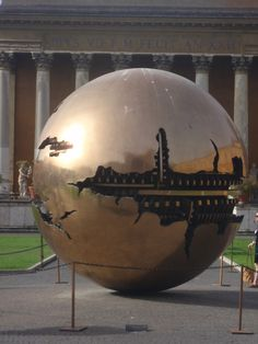 """Sphere within Sphere"" The bronze ball - Vatican..built in 1990.  And it rotates - our wonderful guide was happy to take the risk and show us.  photo by jadoretotravel"