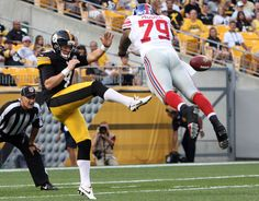 Pittsburgh Steelers punter Drew Butler has his punt blocked by New York Giants defensive end Damontre Moore during the first quarter at Heinz Field.