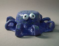 Octopus Pinch Pot...the site has lots of ideas for  pinch pots examples