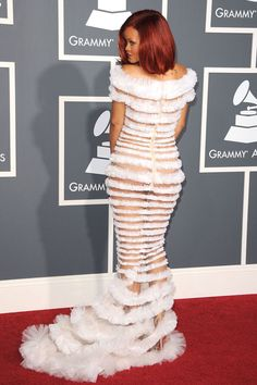 In Jean Paul Gaultier at the 53rd Annual Grammy Awards. See all of Rihanna's best looks.