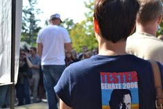 A Tester supporter listens to Jeff Ament speak about the importance of voting for Jon Tester