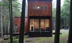 Shipping Container in the forest with great patina to the siding.