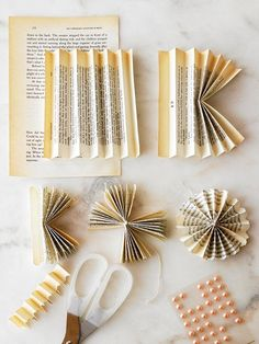Take a page from the great outdoors with this pretty flower-theme paper garland. Accordion-fold an aged book page. Fold in half and trim by evangeline