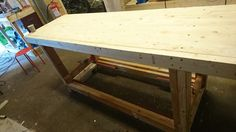 Base made of reused 48x98  Table top made of 36x148 cut down to 36x120 with a frame of 48x98 cut down to 48x86.