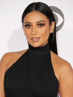 We would like to congratulate Shay Mitchell for two things: winning a People's Choice Award last night for Pretty Little Liars and totally killing it in the makeup game with the best smoky eyes we've seen in a long...